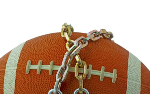 Football in chains.  © Fabio Alcini   Dreamstime.com