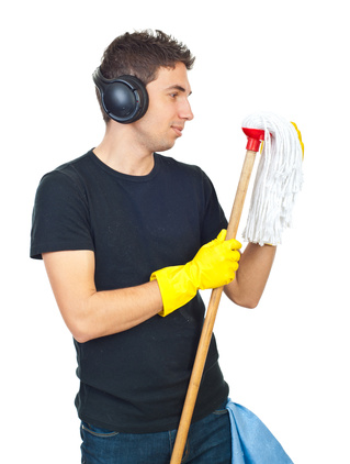 Man with a mop © Gabriel Blaj   Dreamstime.com