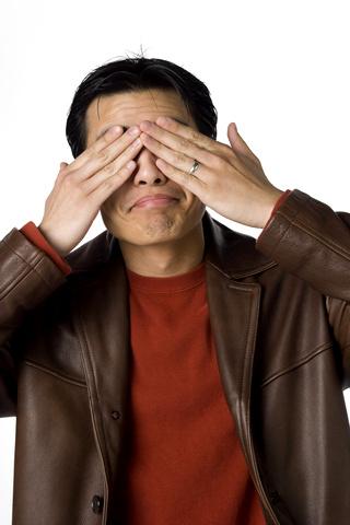 Man covering eyes  © Gabe Palmer | Dreamstime.com
