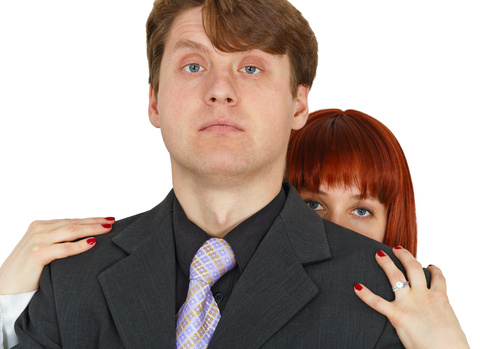Man protecting his wife © Pzaxe | Dreamstime.com