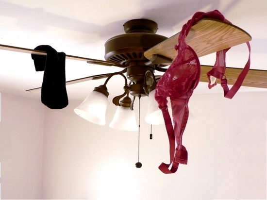 Clothes on the ceiling fan  © Tdoes1l | dreamstime.com