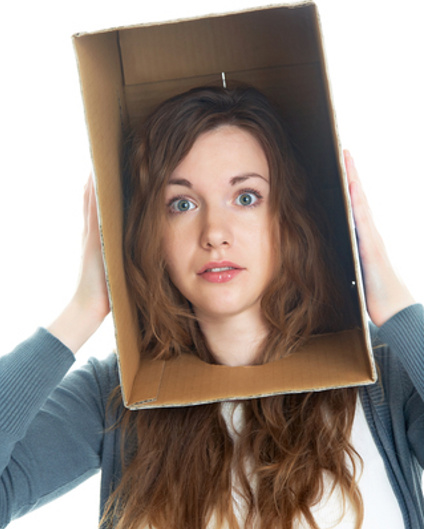 Woman stuck in a box © Yanlev | Dreamstime.com