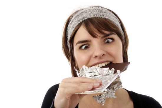 Woman attacking a chocolate bar © bsilvia | dollarphotoclub.com