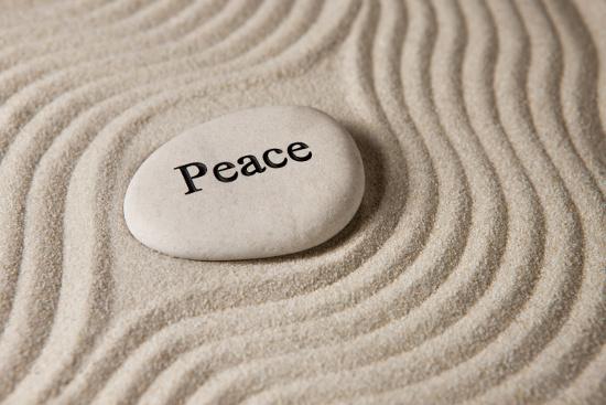 Stone with peace written on it. © Olga Lyubkin | dollarphotoclub.com