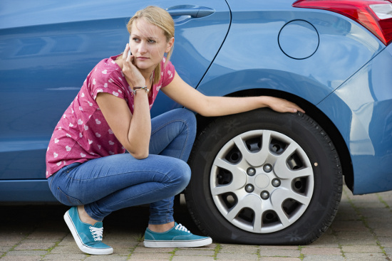 Woman with flat tire © flairimages | dollarphotoclub.com