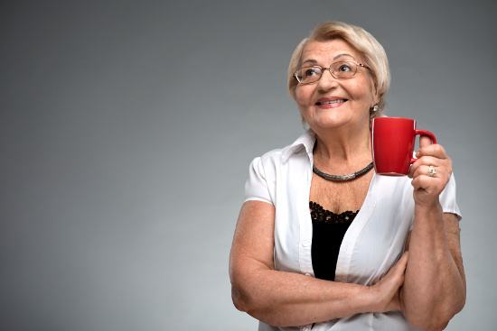 Older woman with coffee © zinkevych | dollarphotoclub.com